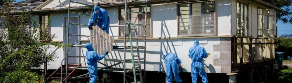 The crew at Integra Build removing asbestos from a home in the Whitsundays